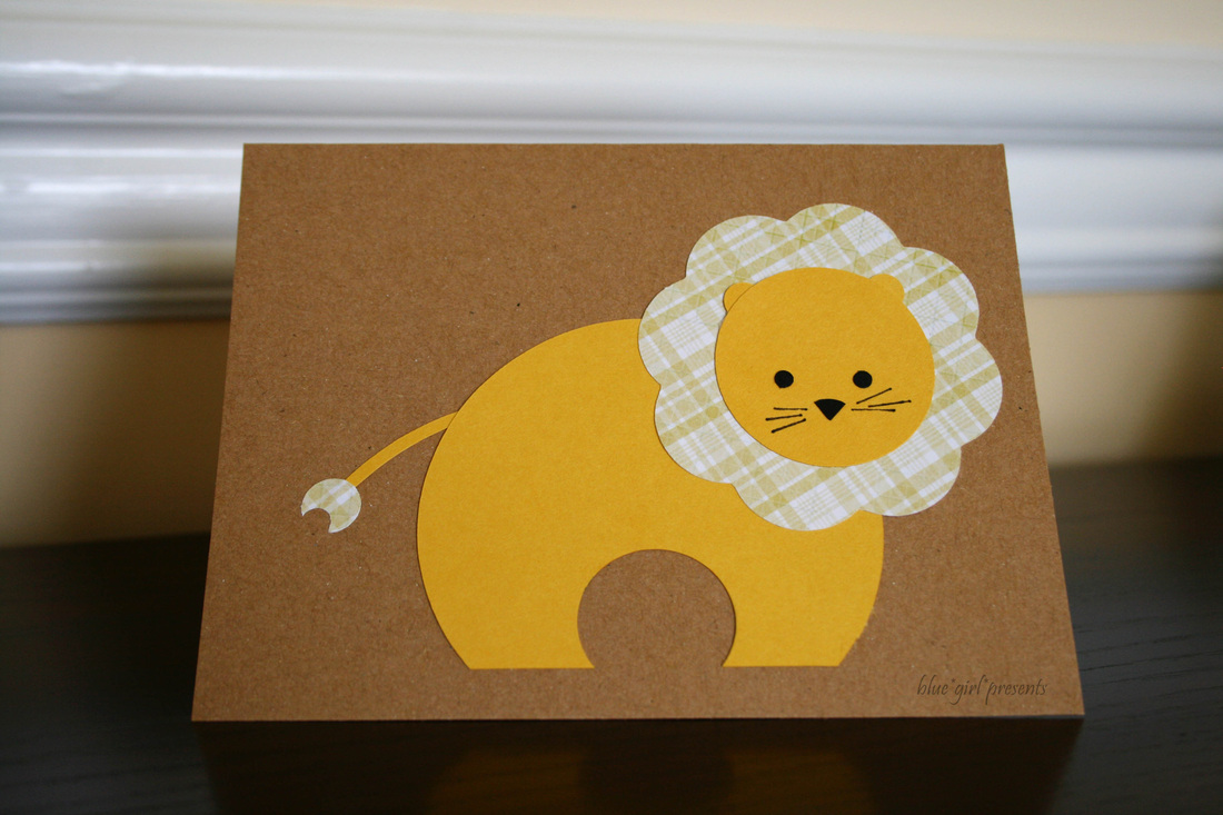 blue girl presents: lion greeting card using simple shapes