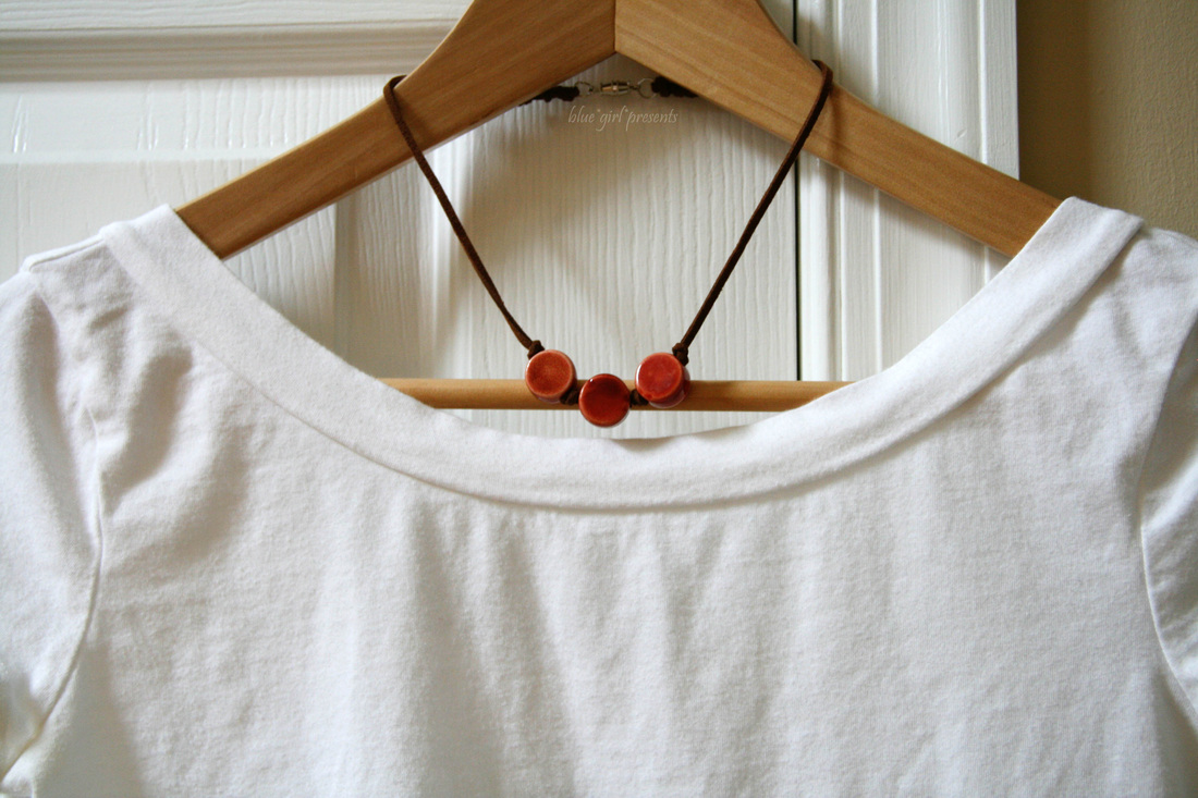 blue girl presents simple diy necklace